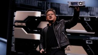 Jensen Huang holding a graphics card.