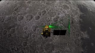 The Indian Space Research Organisation's Chandrayaan-2 moon orbiter is shown studying the lunar surface from above in this still image from a video animation.