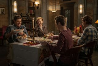 The gang sits down for supper in Supernatural.