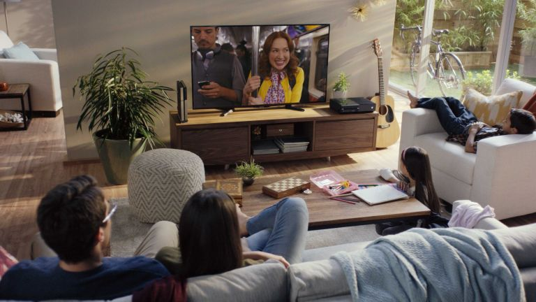 Best streaming service UK: Netflix on TV in living room with family watching