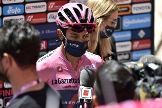 Egan Bernal wears a mask in the Giro d'Italia mixed zone