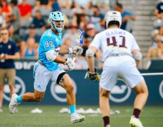 Premier Lacrosse League founder Paul Rabil in the light blue uniform.