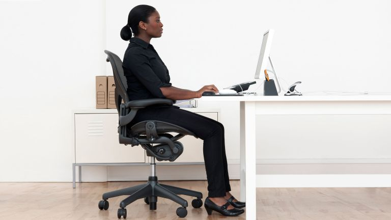 Correct sitting posture can help avoid back issues and pain