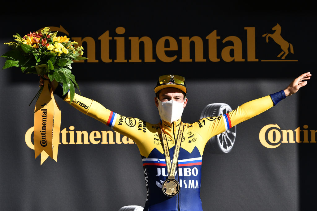 ORCIERES FRANCE SEPTEMBER 01 Podium Primoz Roglic of Slovenia and Team Jumbo Visma Celebration Medal Flowers Mask Covid safety measures during the 107th Tour de France 2020 Stage 4 a 1605km stage from Sisteron to OrcieresMerlette 1825m TDF2020 LeTour on September 01 2020 in Orcieres France Photo by AnneChristine Poujoulat PoolGetty Images