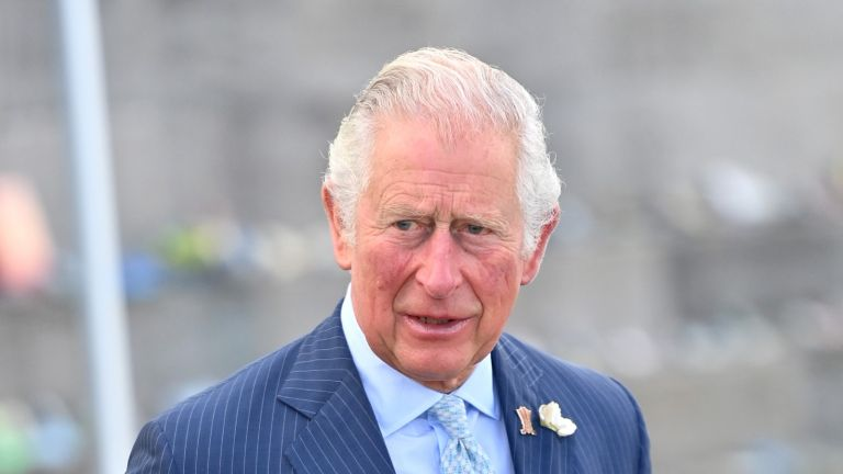 Meghan Markle's wedding dressmaker, Chloe Savage, has shared some harsh words on Prince Charles becoming King. BANGOR, NORTHERN IRELAND - MAY 19: Prince Charles, Prince of Wales at Donaghadee Harbour where he viewed stones that line the walls and were decorated with messages of hope by local people during the pandemic on May 19, 2021 in Bangor, Northern Ireland. (Photo by Samir Hussein - Pool / Getty Images)