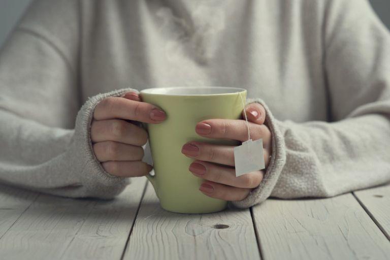 woman sitting with tea mug