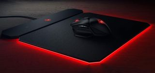 HP wireless gaming mouse and Qi-enabled charging pad