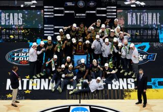 The Baylor Bears pose with the National Championship trophy after winning the National Championship game of the 2021 NCAA Men's Basketball Tournament against the Gonzaga Bulldogs at Lucas Oil Stadium on April 05, 2021 in Indianapolis, Indiana. The Baylor Bears defeated the Gonzaga Bulldogs 86-70.