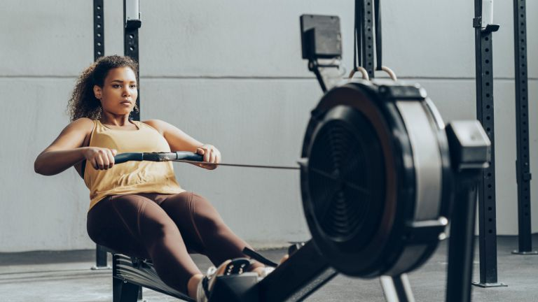 One woman works out on one of the best rowing machines