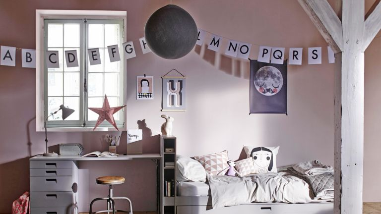 how to design a kid's room: blush toned kid's bedroom with alphabet bunting, a single bed, desk and sweet patterned posters and bedding by cuckooland