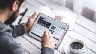 Man reading news on tablet