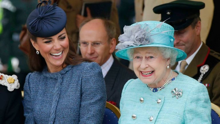 Catherine, Duchess of Cambridge and Queen Elizabeth II watch part of a children's sports event while visiting Vernon Park during a Diamond Jubilee visit to Nottingham on June 13, 2012