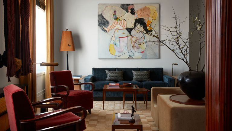 New York apartment living room in cosy colours with mid century furniture