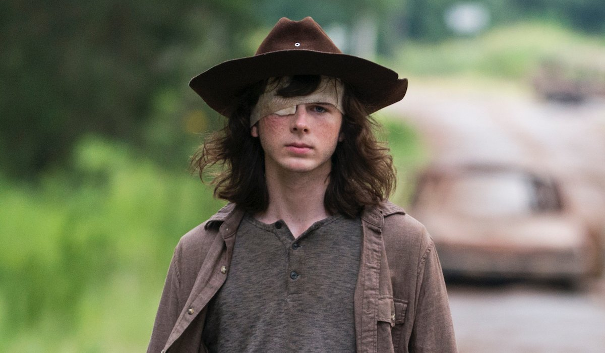 carl in eyepatch and hat the walking dead