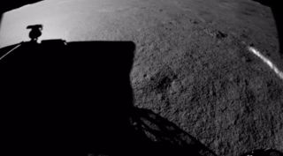 Image from Yutu-2 showing its shadow on the lunar regolith.