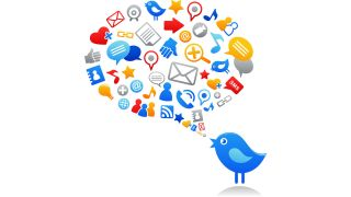 Blue Twitter bird with speech balloon filled with social media and computer icons.