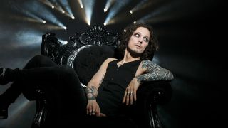a portrait of Ville Valo sat in a chair