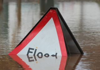 Flooded flood sign, global warming