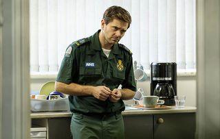 Michael Stevenson as paramedic Iain Dean