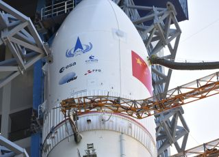 The Long March-5 rocket for China's Tianwen-1 Mars mission was transported to the launch area at China's Wenchang Space Launch Center on July 17, 2020. Note the logos of the European (ESA), French (CNES), Argentine (CONAE) and Austrian (FFG) space agencies in addition to that of the China National Space Agency (CNSA).