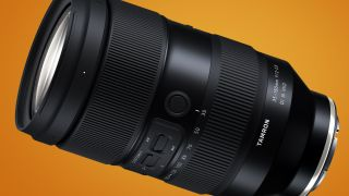 The Tamron 35-150mm f/2-2.8 zoom lens on an orange background