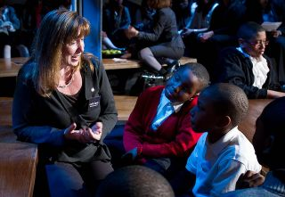 NASA Deputy Administrator Lori Garver talks with middle and high school students at a NASA forum to encourage students to pursue careers in science, technology, engineering and mathematics, March 22, 2011 in New York. Fashion designer Donna Karan's Urban