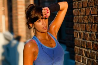 A woman looks exhausted during her workout.