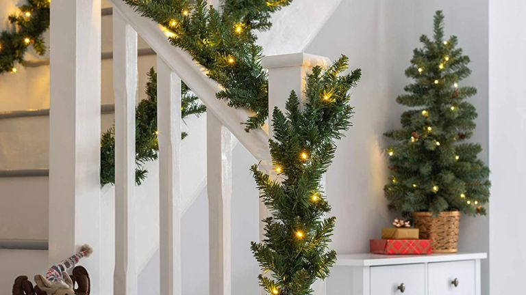 pre lit Christmas decoration deal on garland round staircase