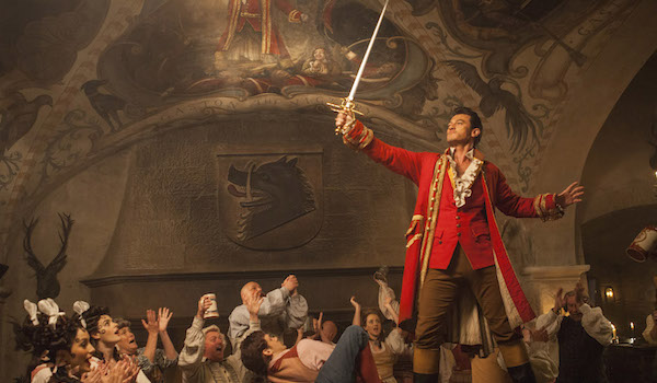 Gaston holding sword in front of crowd