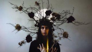 French singer Ricinn wearing a twig headdress
