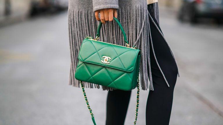 woman holding chanel handbag