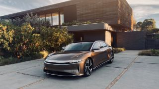 Lucid Air parked outside a modern hosue