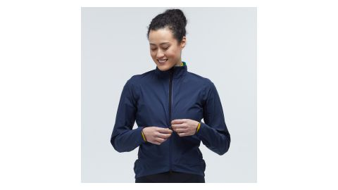 Woman wearing the Velocio Ultralight Rain Jacket