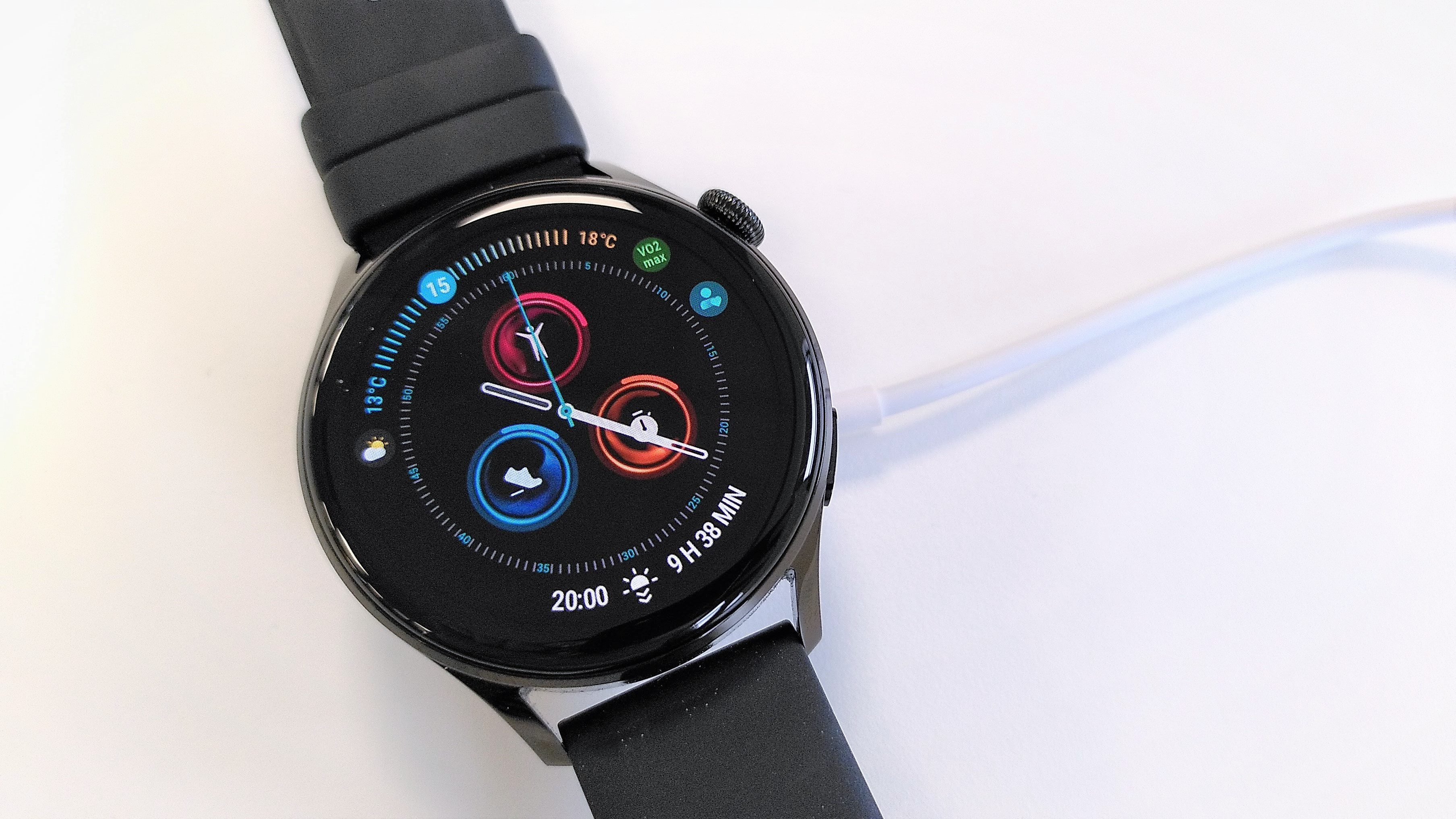 Huawei Watch 3 attached to charger