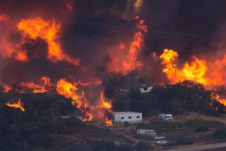 Flames sweep through a rural community at the Blue Cut Fire on Aug. 17, 2016, near Wrightwood, California.