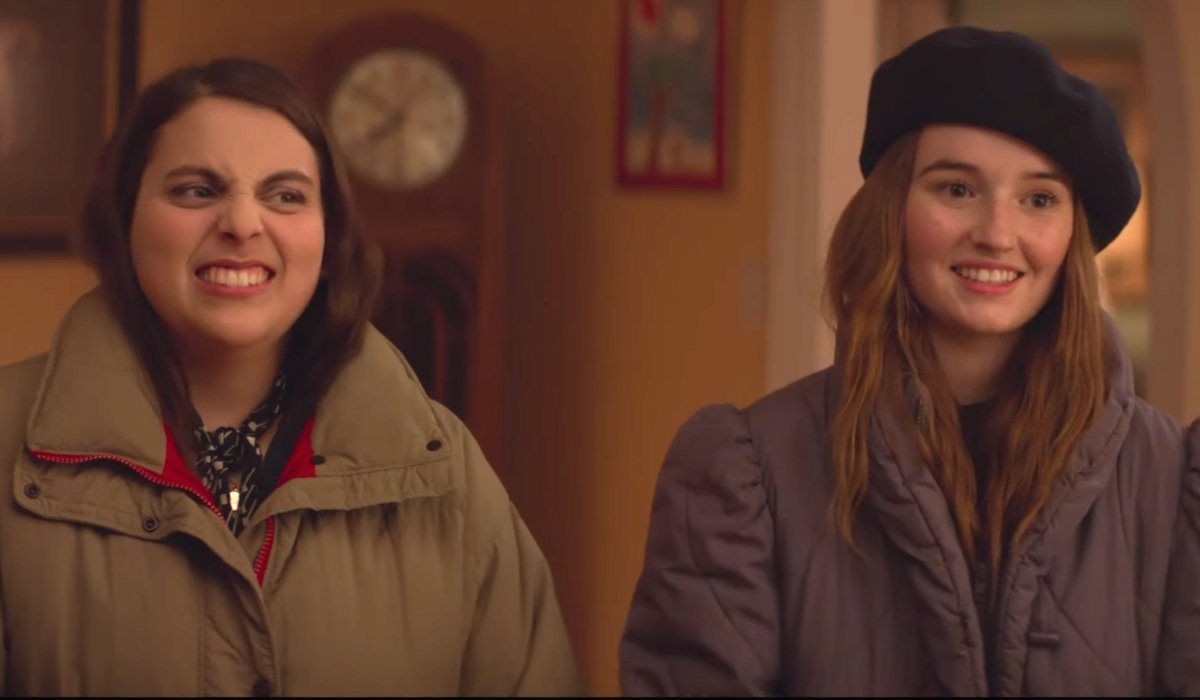 Booksmart the girls listening to some adults in heavy coats