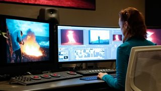 Video editing software: Woman using Premiere Pro