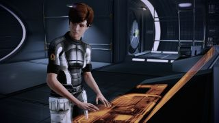 Kelly Chambers at her console in Mass Effect 2 Legendary Edition