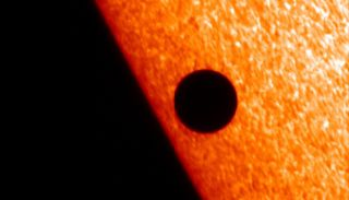 Japan's Hinode spacecraft captured this image of Mercury passing in front of the sun on Nov. 8, 2006, using the spacecraft's Solar Optical Telescope instrument.