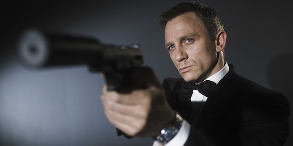 Daniel Craig with a silenced pistol as James Bond
