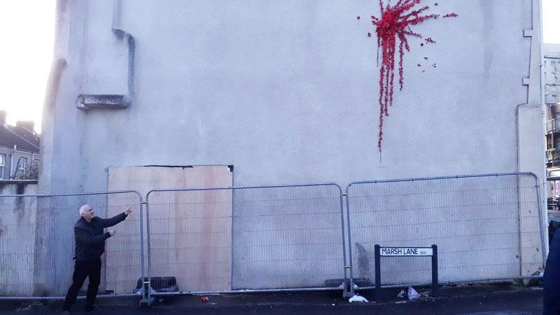 Banksy's Bristol graffiti is covered up following vandalism