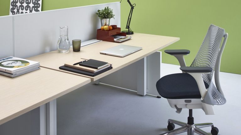 Best office chairs hero image showing Herman Miller Sayl in office environment