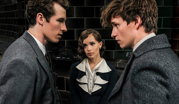 Brothers Newt and Theseus Scamander, with Leta Lestrange between them