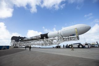 SpaceX's first Falcon 9 rocket destined to fly three times is rolled out to its launch pad at the Vandenberg Air Force Station in California on Dec. 1, 2018. The rocket is scheduled to launch 64 satellites into orbit on Dec. 3.