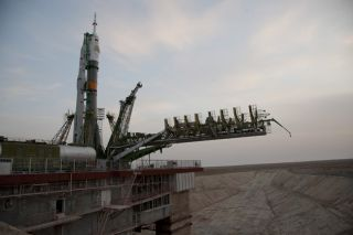 The Soyuz launcher carrying the Soyuz TMA spacecraft is erected on the launch pad at the Baikonur Cosmodrome in Kazakhstan. It will bring NASA astronaut Catherine Coleman, Russian cosmonaut Dmitry Kondratyev and European astronaut Paolo Nespoli to the Int