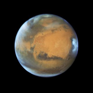 A global view of Mars, captured by the Hubble Space Telescope. The wide view lets scientists observe how climate impacts the entire planet.