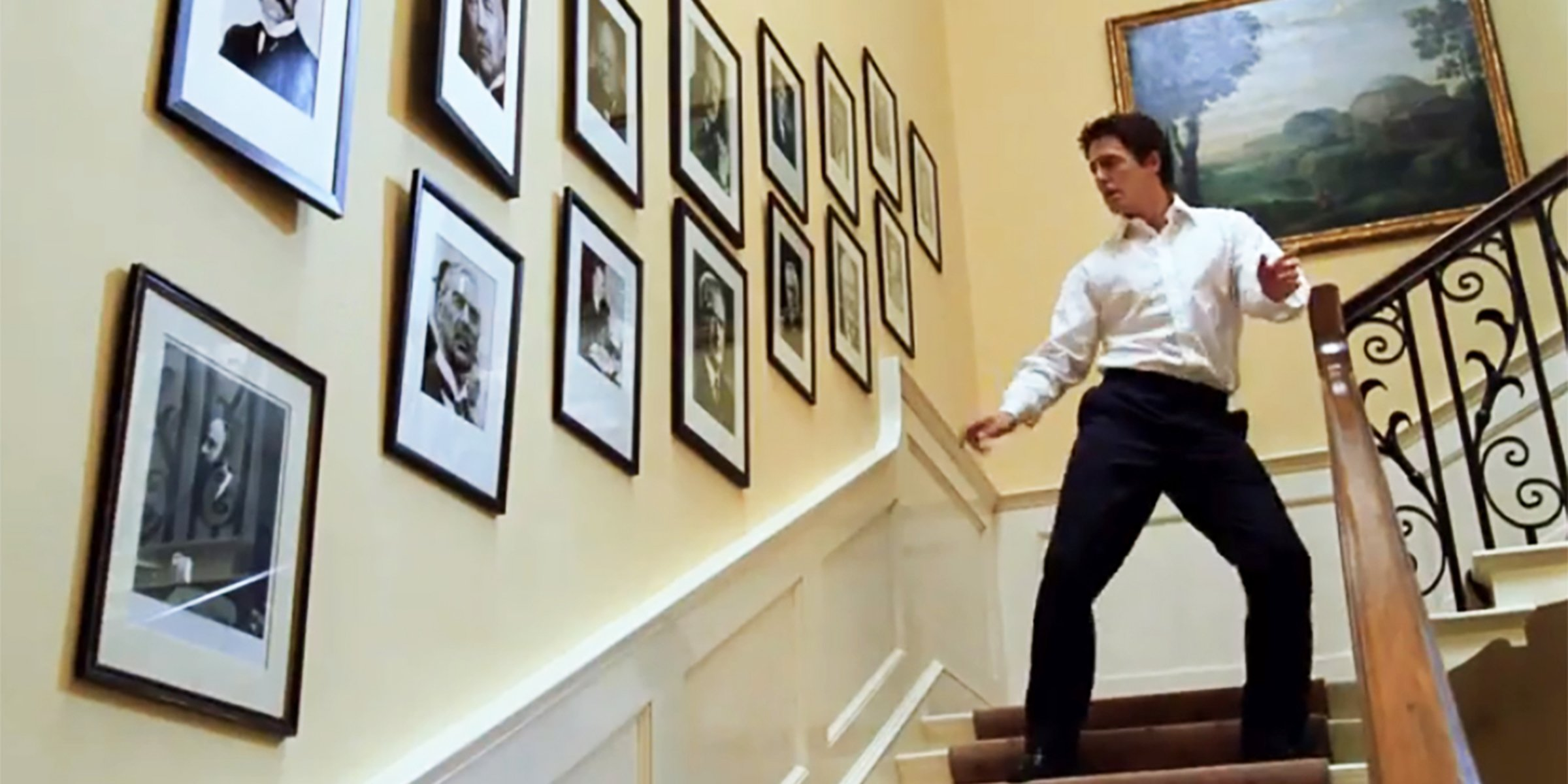 Hugh Grant dancing on stairs in Love Actually