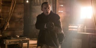 Mission: Impossible Fallout Simon Pegg clears a room, gun drawn