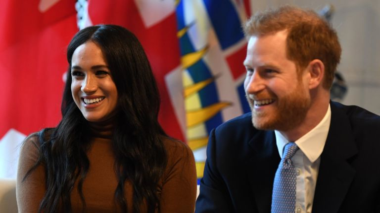 Prince Harry and Meghan, Duchess of Sussex smile during their visit to Canada House in thanks for the warm Canadian hospitality and support they received during their recent stay in Canada, on January 7, 2020 in London, England