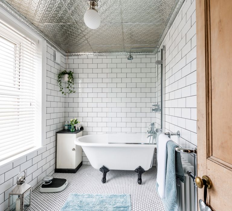 Bathroom with mirrored tile ceiling
